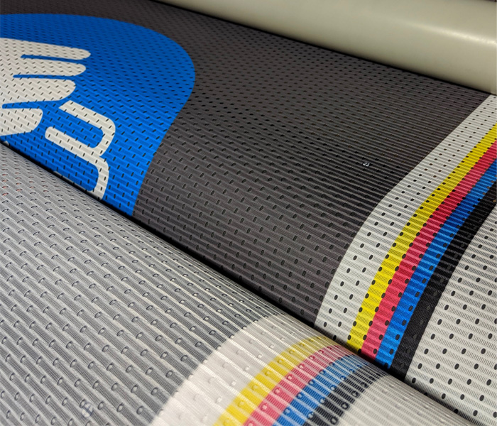 Mesh Banner - a material with a mesh structure, ideal for advertising in places with strong winds